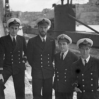Officers of UPHOLDER. Left to right: Lieut F Ruck-Keene; Lieut Cdr Wanklyn, VC, DSO, RN; Lieut J R Drummond, RN; Sub Lieut J H Norman, RNVR