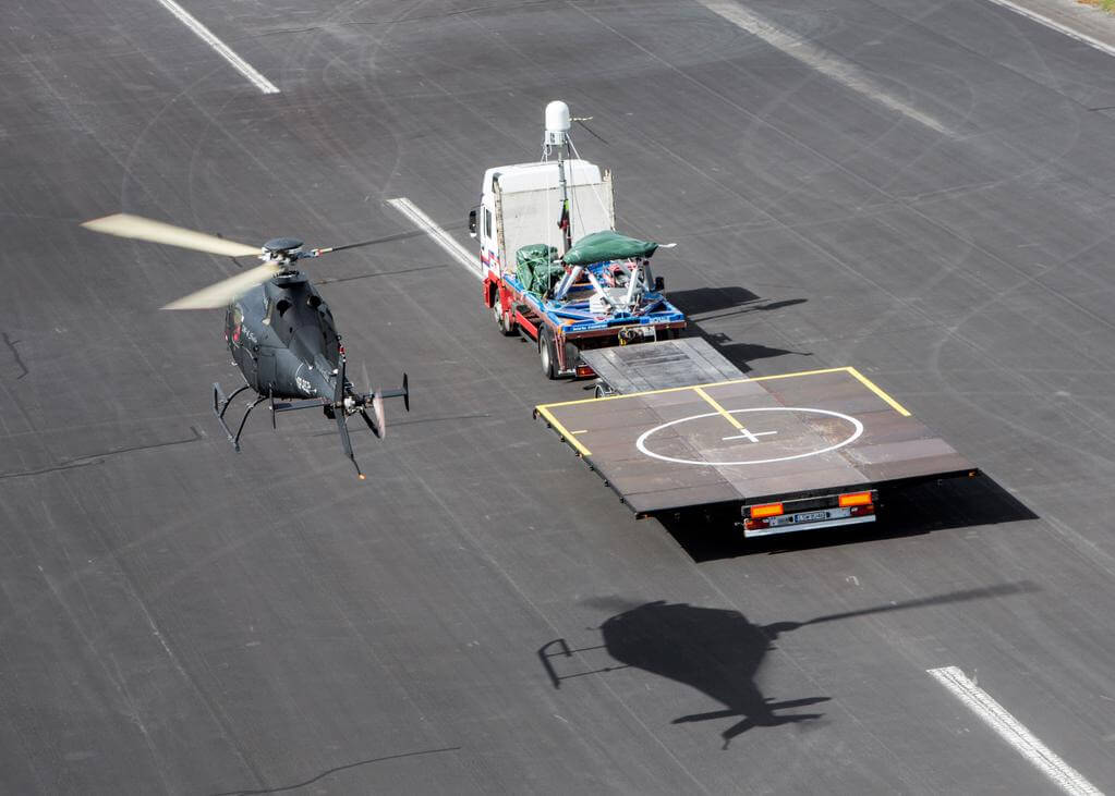 W-4 Solo unmanned helicopter conducted simulated landings on moving vehicles