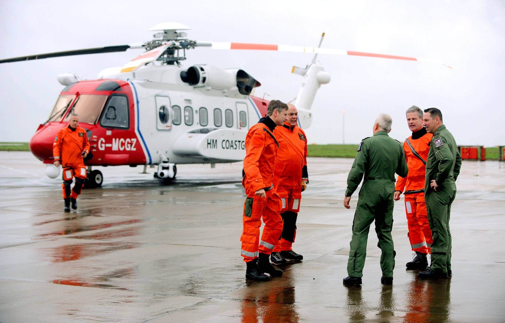 Naval aircrew meet their civilian replacements at handover ceremony at RNAS Culdrose. Note the size of the Sikorsky SH