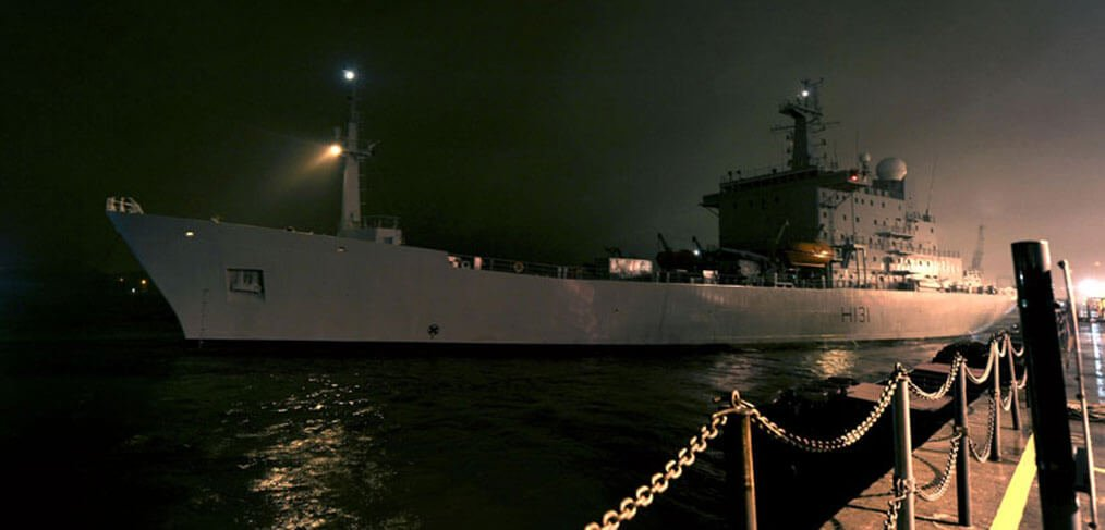 HMS Scott departs Devonport at night