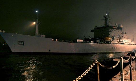 HMS Scott departs Devonport at night
