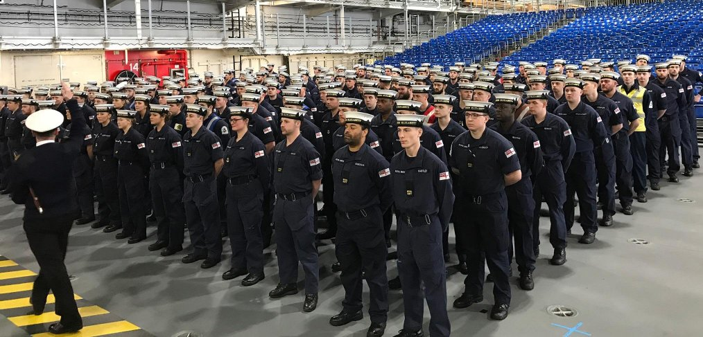 Sailors aborad HMS Queen Elizabeth practice drills for the commissioning ceremony