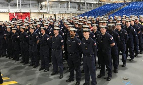Sailors aborad HMS Queen Elizabeth practice drills for the commissioning ceremony