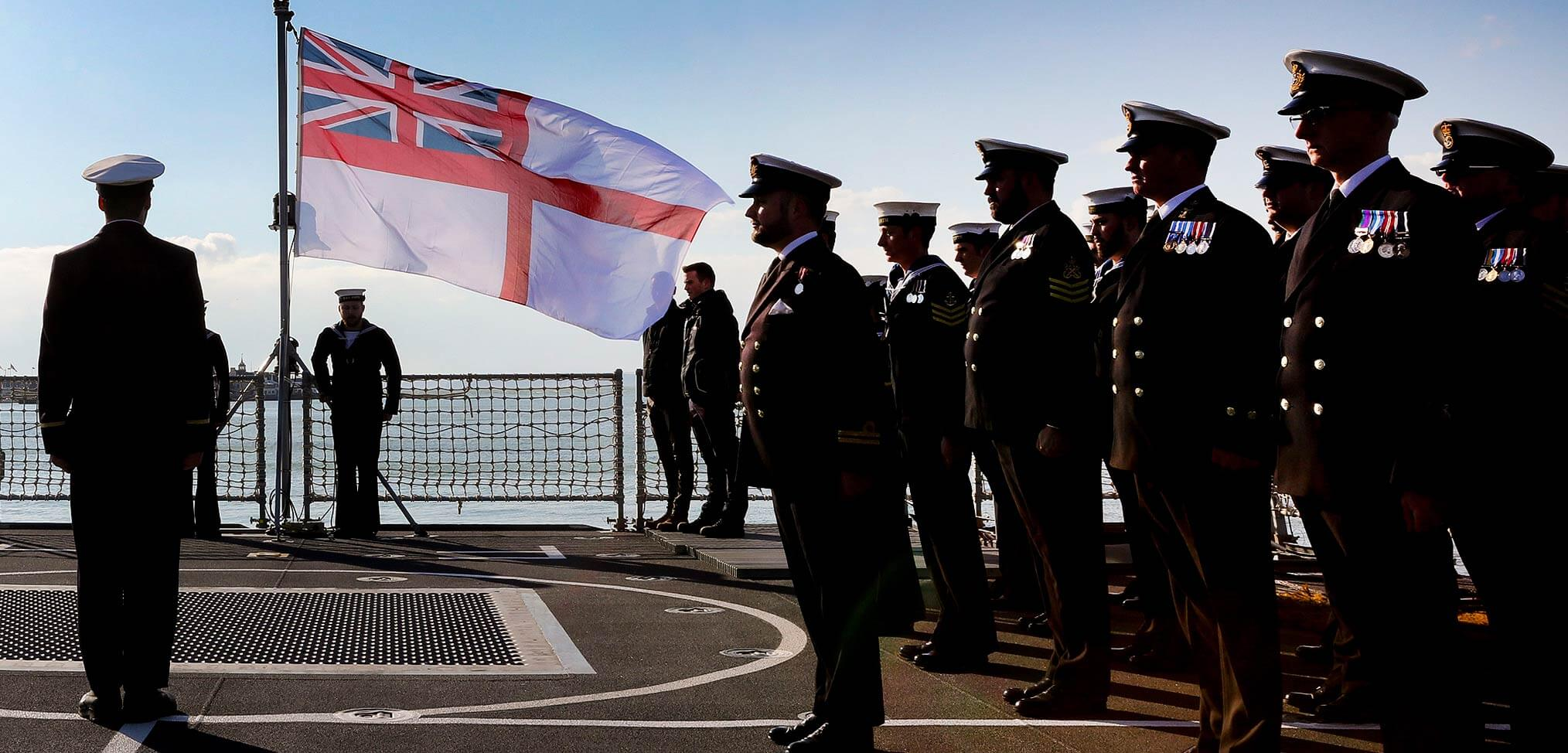 Royal Navy sailors commissioning ceremony White Ensign