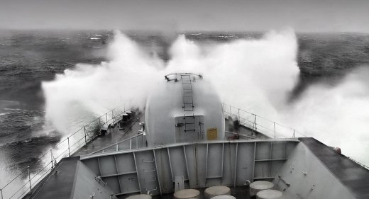 Friget ploughs through stormy seas