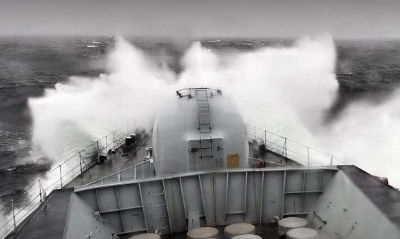 Friget ploughs through stormy seas
